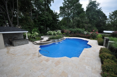Walnut travertine paver patio in a French pattern Long Island NY
