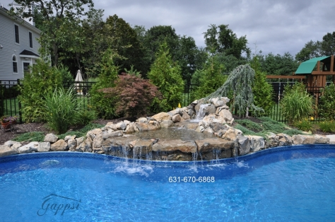 Swimming Pool Moss Rocks Waterfall Built By Gappsi Landscaping on Long Island NY