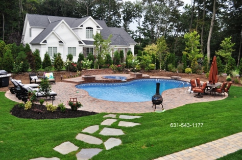 landscape backyard design with free form vinyl pool, spillover spa, patio, stepping stone