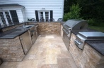 gunite-swimming-pool-with-spill-over-spa-patio-and-outdoor-kitchen-with-twin-eagle-appliances.NEF_