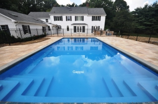 gunite-swimming-pool-with-spill-over-spa-patio-and-outdoor-kitchen