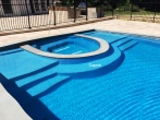 gunite-swimming-pool-with-spill-over-spa-sundeck-patio-and-outdoor-kitchen