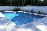 vinyl swimming pool with travertine patio and pool coping by gappsi