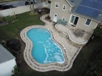 gunite swimming pool with spa feature and stairs by gappsi